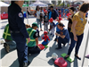 Spiderman Learning Hands On CPR at 2019 La Mesa Pancake Breakfast