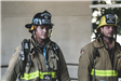 Two Heartland Fire employees standing at memorial stair climb