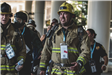 Group of people in firefighter turnouts at 9-11 memorial stair climb