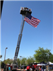 American Flag hanging from Fire Truck Ladder
