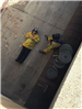 Firefighter Standing by Another Firefighter Who Is Laying Down
