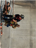Firefighters Propelling Down Side of Wall 16