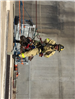 Firefighters Propelling Down Side of Wall 19