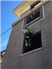 Firefighters Propelling Down Side of Wall 42