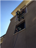 Firefighters Propelling Down Side of Wall 54