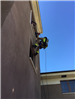 Firefighters Propelling Down Side of Wall 56