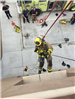 Firefighters Propelling Down Side of Wall 70