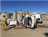 Firefighters Training on Crashed White Vehicles