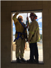 Two Firefighters Standing on Window 1