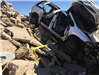Crashed Minivan Tied by Rocks