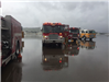 Fire and Rescue Vehicles Parked on Cloudy Rainy Day 1