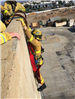 Firefighter Hanging from Wall