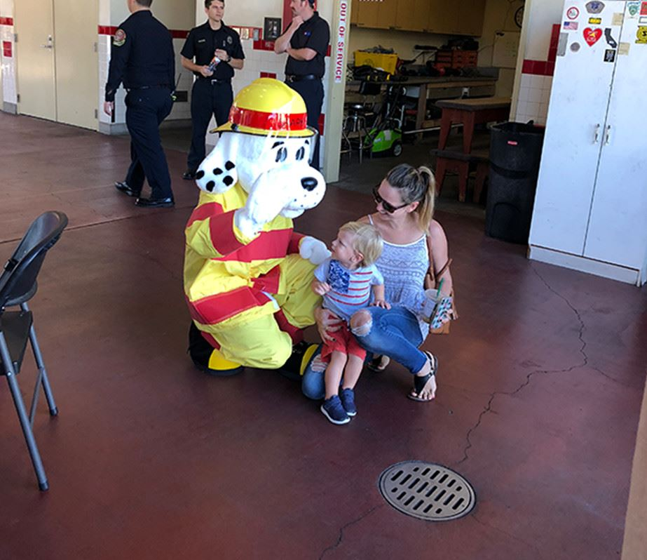 Sparky the Fire Dog Mascot talking to child