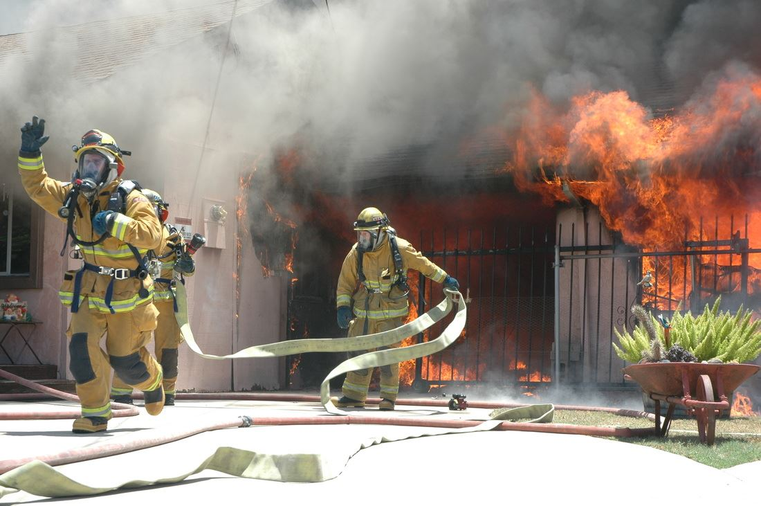 Two firefighters working on house fire